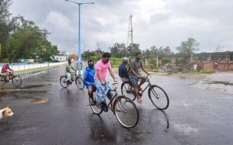 East Midnapore: Locals ride bicycles on a cloudy day, ahead of Cyclone