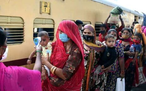 BMC health workers check body temperature and oxygen saturation levels of passengers before the Antigen test at Dadar station. (ANI)