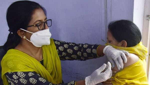 A medical worker inoculates a woman with a dose of Covishield coronavirus vaccine at a camp in Amritsar, Punjab.  (HT)