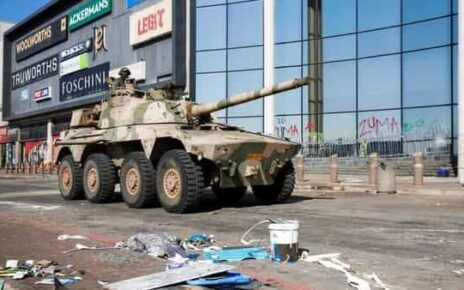 A military tank patrols near a shopping centre that was damaged after several days of looting following the imprisonment of former South Africa President Jacob Zuma (REUTERS)