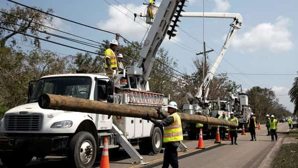 Power restoration workers are seen in the aftermath of Hurricane Ida landfall in Louisiana (REUTERS)