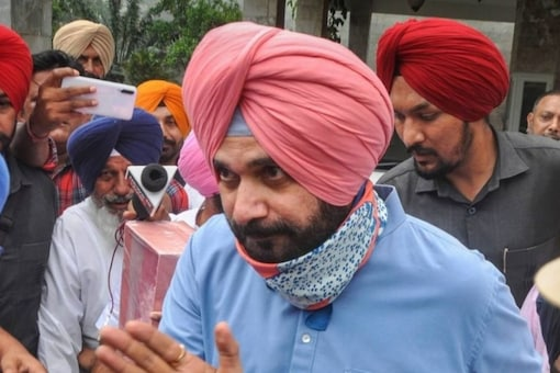 Navjot Singh Sidhu alleged that the Kejriwal government had last year notified one of the farm laws   despite protests. (PTI)