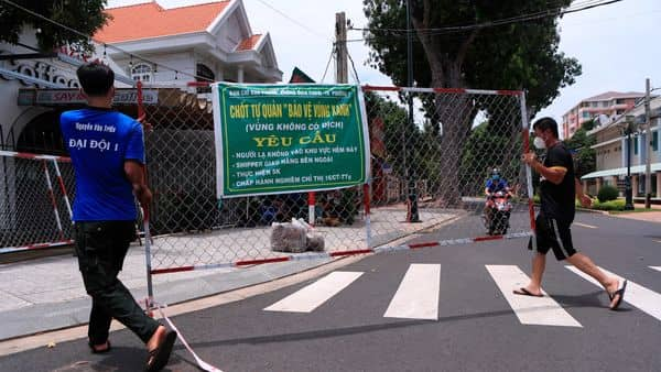 People remove a barricade in Vung Tau, Vietnam will lift a lockdown order in its largest city on Friday, ending almost three months of strict movement restrictions to curb a coronavirus surge. (Photo: AP)