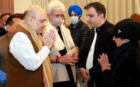 Union Home Minister Amit Shah exchanges greetings with the family members of the security personnel, who was killed fighting terrorists in Poonch, in Srinagar on Saturday. (ANI)