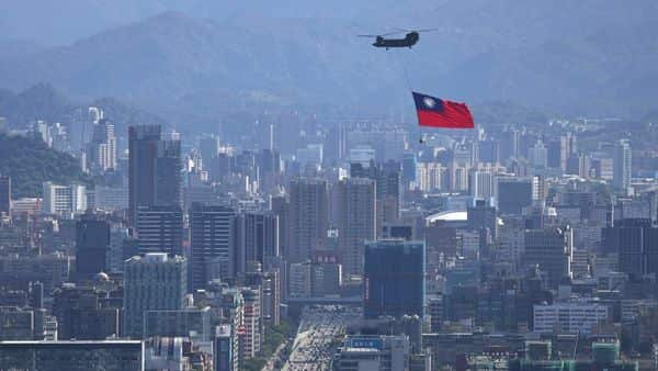 A Taiwan flag is carried by a Chinook helicopter (Photo: Reuters)